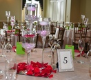 Table setup with flowers and glasses for a bridal shower