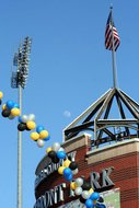 Black, blue and yellow outdoor balloon arch